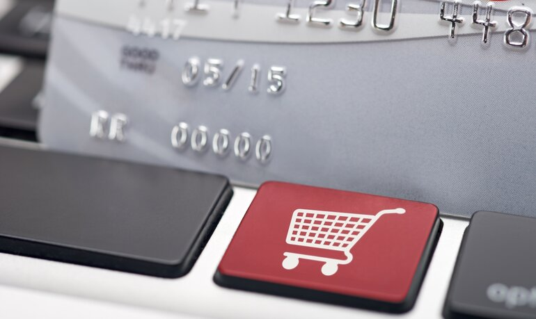 Keyboard with shopping cart icon and credit card to depict online shopping