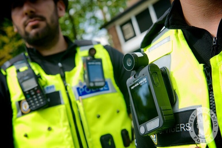 Police officers wearing body cameras