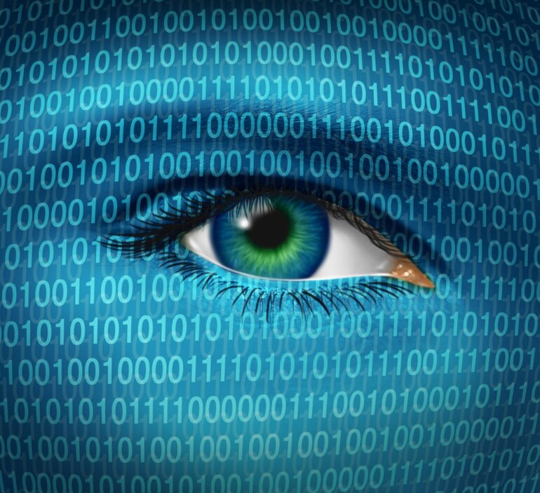 Online privacy depicted by a human eye surrounded by binary code
