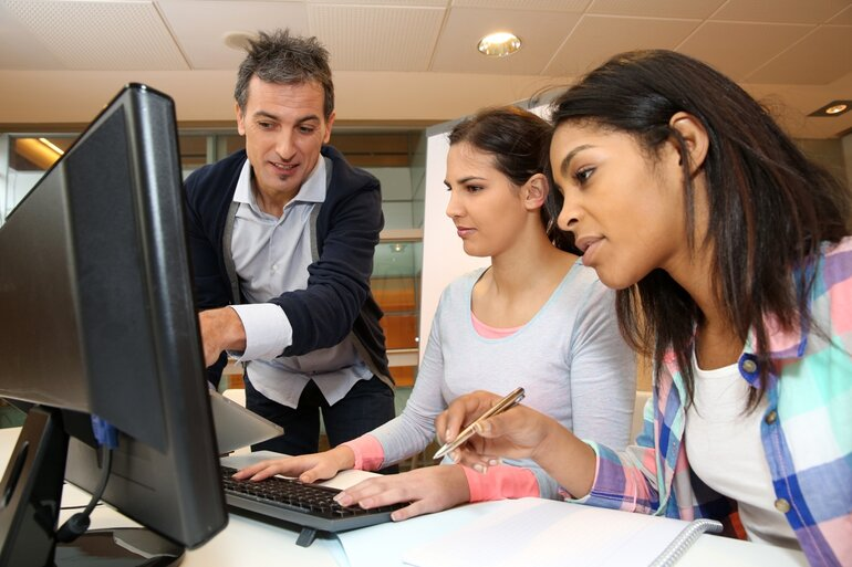 Young people learning at a computer