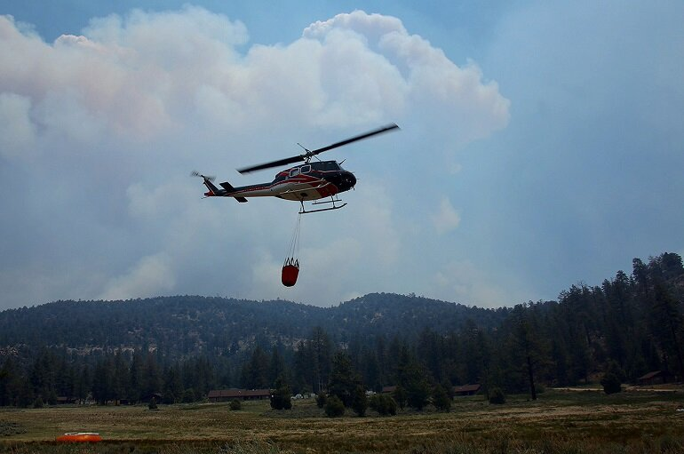 Water-dropping helicopter picks up a load to fight the Lake Fire