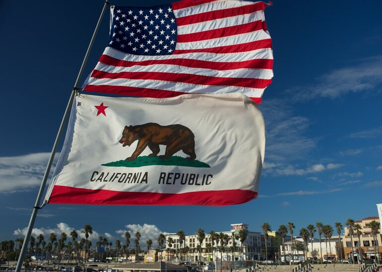 The U.S. and California flags fluttering in the breeze.