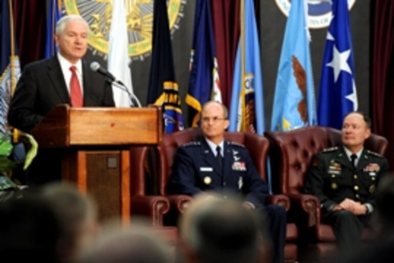 Robert Gates (left), U.S. Defense Secretary; Army Lt. Gen. Keith Alexander (far right), first U.S. cyber-commander/Photo by Cherie Cullen, Deptartment of Defense