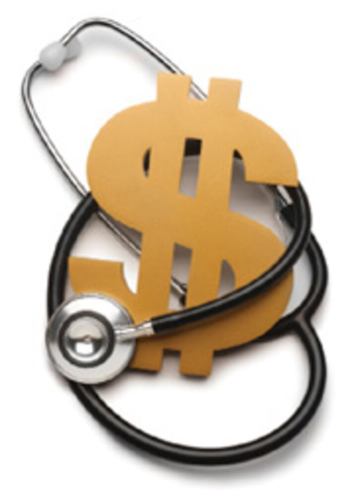 Dollar sign and stethoscope/Photo by iStockphoto