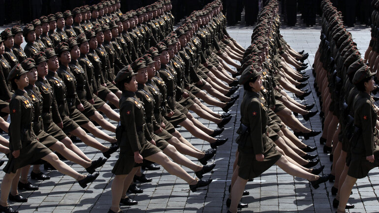 In an April 15, 2012 photo, North Korean soldiers attend a mass military parade in Pyongyang's Kim Il Sung Square to celebrate 100 years since the birth of the North Korean founder Kim Il Sung