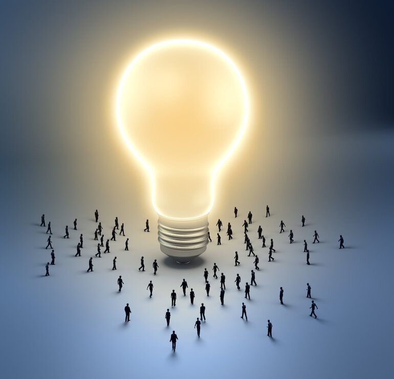 Leadership, Group of people walking toward a light bulb