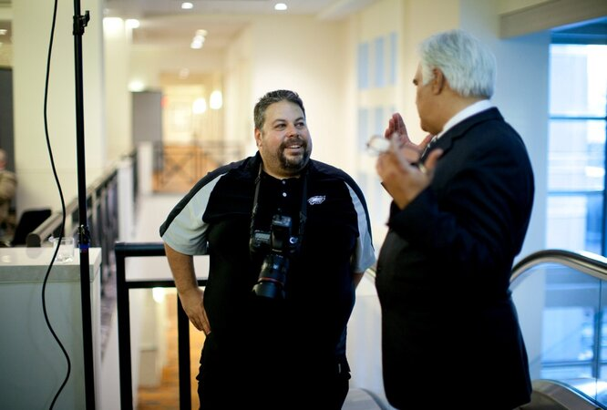 Hawaii CIO Sonny Bhagowalia quizzes GovTech photographer Mike Wylot after the shoot.