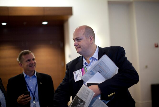 Michigan's John Nixon (right) and David Behen prepare for a panel on collaboration between budget directors and CIOs