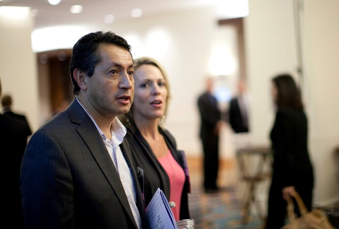 California CIO Carlos Ramos and Colorado CIO Kristin Russell head for a meeting session.