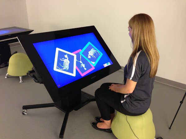 Head Librarian Ashley Eklof demonstrates one of the interactive games