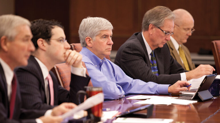 Mich. Gov. Rick Snyder in a meeting