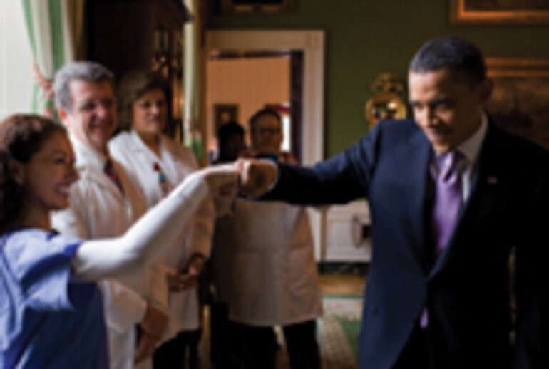 President Barack Obama fist-bumps a medical professional in the White House prior to a health-care event in March/Photo courtesy of the White House/Pete Souza