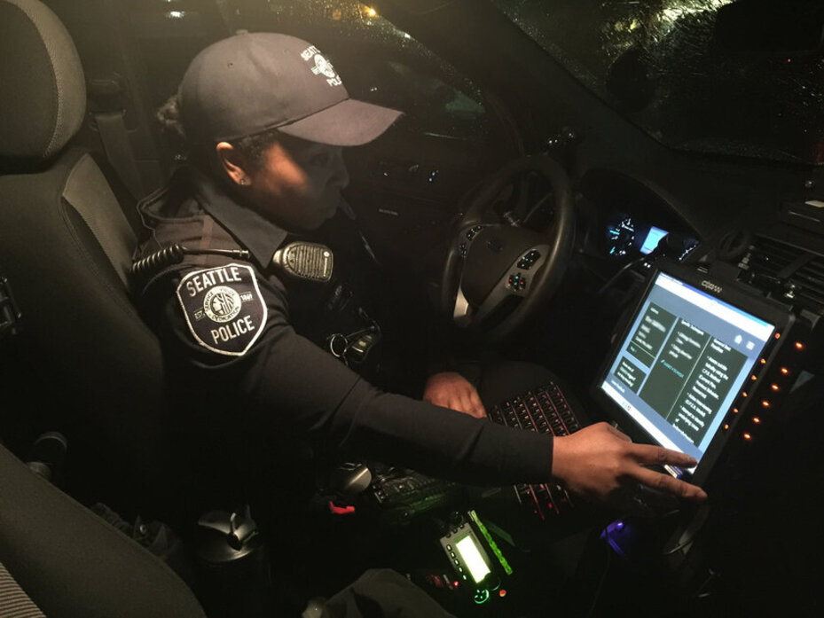 A Seattle police officer uses the RideAlong system.