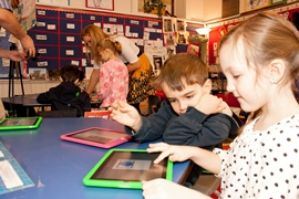 Children using iPads at Kindy