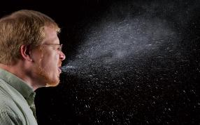 Man sneezing/Photo by James Gathany/Centers for Disease Control and Prevention